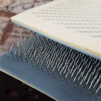Close up of metal teeth on 12 inch flexible drawing card for prebond and bulk hair extensions