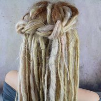 Hair chain across blonde dreadlocks at back of head