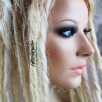 Brass metalwork dread wrap on model with blonde dreadlocks