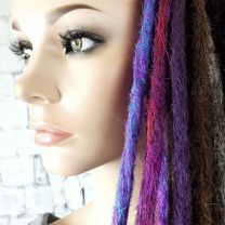 Blue and purple, pink and purple, and dark purple synthetic crocheted dreadlocks on model